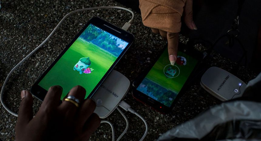"YOGYAKARTA, INDONESIA - JULY 23:  People play Pokemon Go game on  smartphones at Gembira Loka Zoo on July 23, 2016 in Yogyakarta, Indonesia. ""Pokemon Go,"" which uses Google Maps and a smartphone has been a smash-hit in countries where it is available and already popular in Indonesia even though it has not been officially released. Indonesians have been downloading the game by using a proxy location which gives them access to app stores of other countries as security officials have voiced worries that the game could pose a security threat.  (Photo by Ulet Ifansasti/Getty Images)"